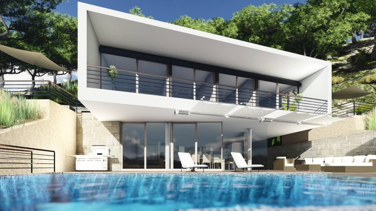 Blick auf das Haus mit Poolterrasse in der Cala Llamp auf Mallorca