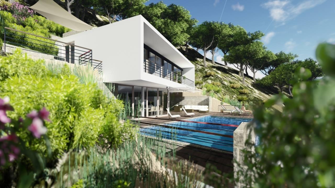 Seitlicher Blick auf das Haus mit Poolterrasse in der Cala Llamp auf Mallorca